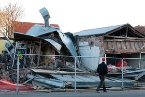 Shops in Opawa collapsed  after the 6.0 earthquake in Christchurch. Photo / NZPA, David Alexander