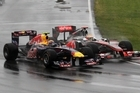 Red Bull's Mark Webber and McLaren's Lewis Hamilton collide on the first corner after the safety car pulled off in the Canadian Grand Prix in Montreal. Photo / AP