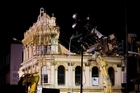 Demolition crews move in to pull down the Palace Hotel in Victoria Street, Auckland last year.