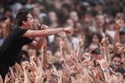 Jon Toogood of Shihad rocked the crowd at Big Day Out 2011 in Mt Smart Stadium, where the event has been held since 1994. Photo / Richard Robinson