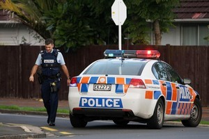 Armed Police cordon off streets in Blockhouse Bay Monday. Photo / Natalie Slade