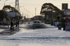 Water mains burst in Ferry Rd near Sumner after yesterday's two  major aftershocks and many smaller jolts.  Photo / Getty Images
