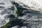 The ash plume is seen drifting over New Zealand in this photo from NASA. Photo / NASA