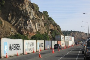 Containers protecting motorists from rock falls at Shag Rock corner on the road to Sumner. Photo / Amanda Cropp