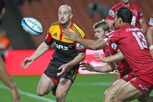Brendon Leonard of the Chiefs passes under pressure. Photo / Getty Images.
