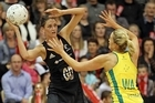 Anna Scarlett of New Zealand looks to pass under pressure from Chelsea Pitman of Australia. Photo / Getty Images