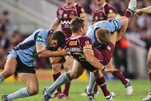 Expect some more big hits when New South Wales and Queensland clash in Origin II. Photo / Getty Images