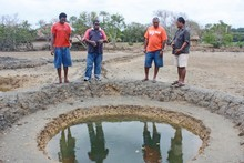 Michael Croker (at right) supervises traditional salt-making at Lomawai, Fiji. Photo / Jim Eagles