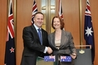 New Zealand Prime Minister John Key with Australian Prime Minister Julia Gillard at Parliament House in Canberra. Photo / NZPA/Mark Graham