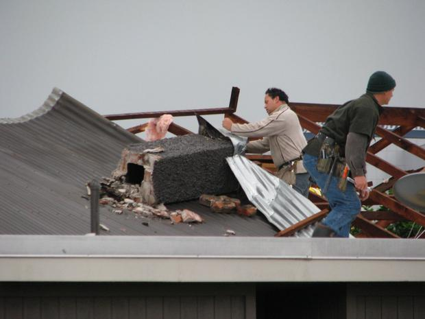 Damage to a roof in New Plymouth. Photo / Warwick  Foy