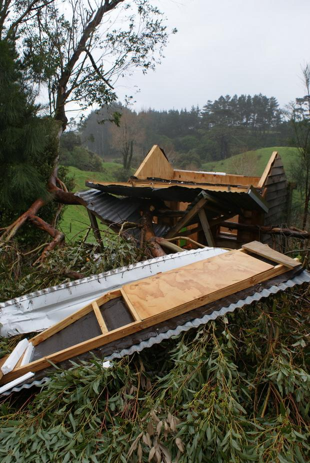 Damage to a children's playhouse on Waireka Road East, rural New Plymouth. Photo / Andrew Crawshaw
