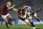 Peter Saili of the Blues is tackled by Jamie Mackintosh of the Highlanders. Photo / Getty Images