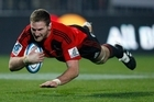 Kieran Read scored the decisive try off an intercept as the Crusaders beat the Sharks last night. Photo / Getty Images