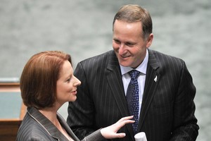 Australian Prime Minister Julia Gillard and New Zealand Prime Minister John Key talk after PM Key addressed the House at Parliament, Canberra. Photo / NZPA