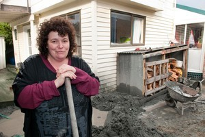 Jackie Lilburn in the quagmire surrounding her home in Retreat Road, Avonside. Photo / David Alexander