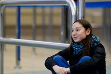Claudia Sandoval, who is trying to get home to Chile, sits at Auckland Airport after flights were cancelled due to ash from the eruption in her homeland. Photo / Dean Purcell