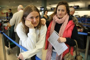 South Africabound English tourists Laura Frazer and Charlotte Billings wait for news on their Qantas flight. Photo / Greg Bowker