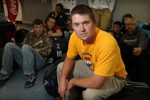 Zach Harper and other Indiana-bound wrestlers wait for news on a flight out yesterday. Photo / Greg Bowker