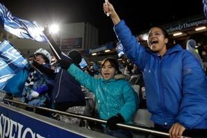 The rain won't keep diehard Blues fans from supporting their team at Eden Park tonight. Photo / Brett Phibbs