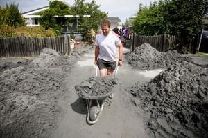 Kieran Read helps with the quake clean up. Photo / Dean Purcell