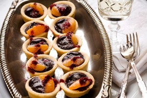 Food: Belgian chocolate tarts with mandarin and plum powder. Photo / Babiche Martens