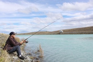 Chris Eagles almost got lucky with two trout on the end of the line in the Tekapo Canal but, alas, they got away. Photo / Jim Eagles