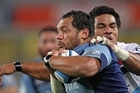 John Afoa of the Blues is tackled by Sitaleki Timani of the Waratahs. Photo / Getty Images