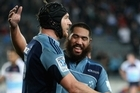 Ali Willilams of the Blues (L) is congratulated on his try by Charlie Faumuina (R). Photo / Getty Images