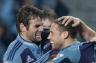 Luke McAlister is congratulated by Jared Payne during the Blues' victory over NSW last night. Photo / Brett Phibbs