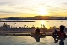 Watch the sunset from one of the pools at the Polynesian Spa. Photo / Supplied