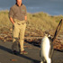 DOC ranger Clint Purches with a rare emperor penguin. Photo / NZPA