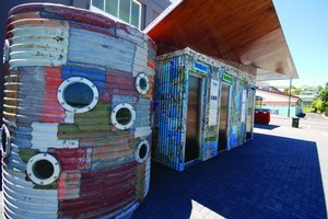 A Helensville public toilet made of corrugated iron sculpted by Jeff Thomson. Photo / Supplied