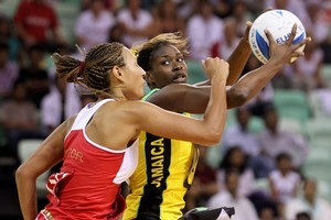 England's Geva Mentor (left) and Jamaica's Romelda Aiken compete for the ball. Photo / Getty Images