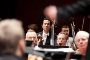 Section principal double bass player Hiroshi Ikematsu focuses on conductor Pietari Inkinen mid-performance. Photo / Olivia Taylor
