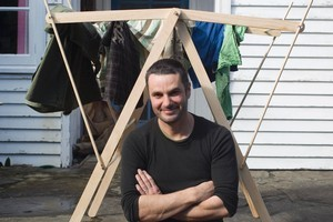 Justin Newcombe shows off his easy-to-construct clothes horse. Photo / Richard Robinson