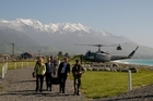 John Key arrives in Kaikoura via Air Force helicopter to launch a new whale watch boat. Photo / Supplied