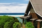Overlooking the sea, Milestone Cottages provide the perfect setting for Gael Milestone's retreats. Photo / Supplied