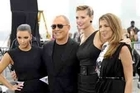 Kim Kardashian put her fashionista abilities to good use in New York City Friday as a guest judge on the upcoming ninth season of 'Project Runway.' Contestants were instructed to put together an outdoor, public runway with models on stilts.
