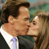 Arnold Schwarzenegger kisses Maria Shriver, after taking his oath of office in Sacramento, California on January 5, 2007. File photo / AP