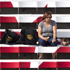A fan eats an ice cream in the bleachers at Ivor Wynne Stadium in Hamilton, Ontario. Photo / AP
