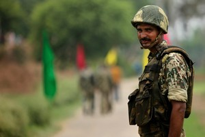 Indian Border Security Force soldier keeps alert at the India Pakistan border. Photo / AP