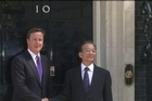 Chinese Premier Wen Jiabao and British Prime Minister David Cameron signed trade deals worth £1.4 billion at a summit on Monday as Wen batted away questions about his country's rights record.