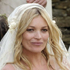 Kate Moss and Jamie Hince smile for photographers following their wedding. Photo / AP