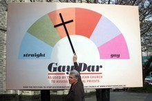 The 'gay-dar' billboard put up outside Auckland's St Matthew in the City late last week has already been vandalised. Photo / NZPA/Rachel Pinder