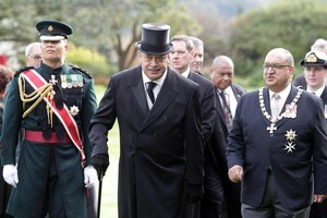 Governor-General Sir Anand Satyanand (right) escorts King George Tupou V at Government House. Photo / Mark Mitchell