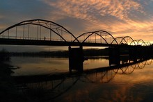 The bridge at sunset: who knew Huntly could be so beautiful? Photo / Tourism Waikato
