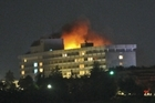 Smoke and flames light up the night at the Intercontinental hotel in Kabul, during a battle where two SAS soldiers were injured last week. Photo / AP