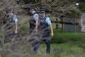 Police search the ground near Burnside Culvert, where a body of a newborn baby was found. Photo / Brett Phibbs