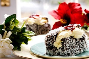 Lamingtons with blackberry jam and cream. Photo / Babiche Martens