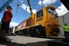 A Chinese-made locomotive being unloaded at the Port of Tauranga last year. Kiwirail's decision to buy wagons from China has prompted threats of industrial action from rail and maritime unions. Photo / Sam Ackland.